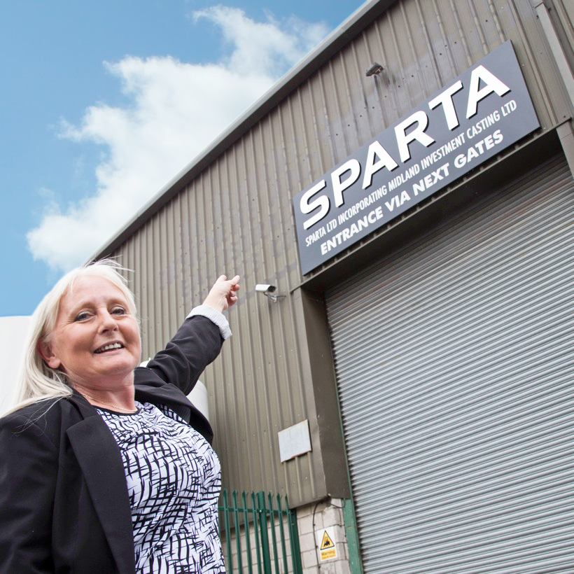 SDA's Sue Lawson showcasing the Sparta's new signage.