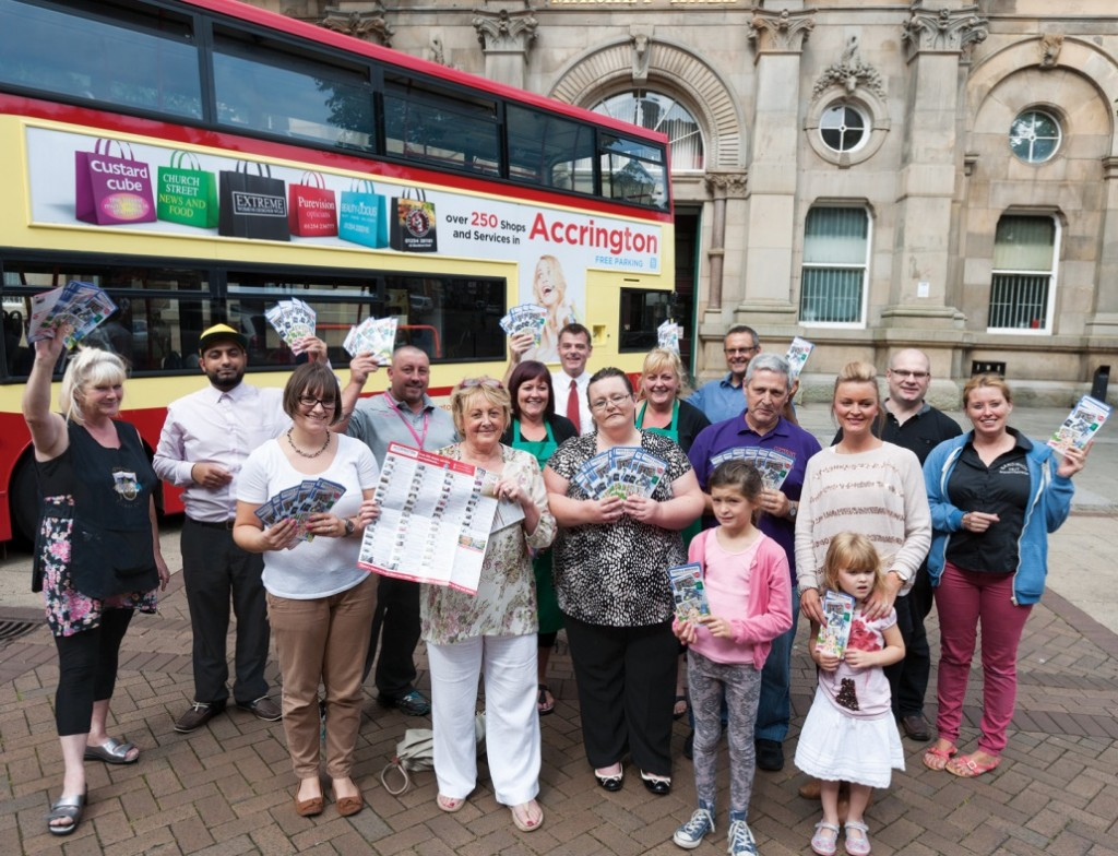 Cllr Clare Pritchard joins some of the retailers featured in the flyer at its official launch in Accrington.